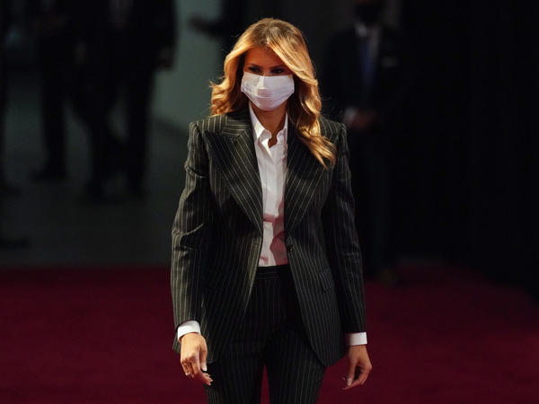 First lady Melania Trump, pictured wearing a face mask at the presidential debate on Sept. 29, said she and the Trumps' son Barron, no longer test positive for the coronavirus.