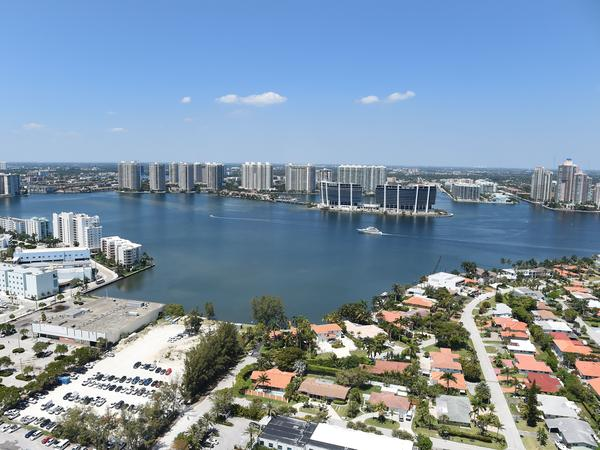 A new study has found that home sale prices and volume appear to be declining in Florida coastal areas at vulnerable-to-rising sea levels compared to coastal areas with less risk. Here, the balcony view from a luxury condo in Sunny Isles Beach, Fla., in 2017.