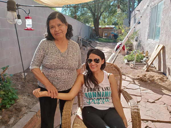 Isabel Calderon (right) with her mother Juana Santos in the backyard of their home in Barelas in Albuquerque.