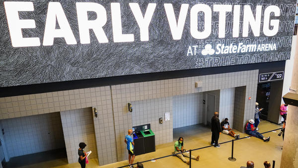 People wait in line to vote early at the State Farm Arena in Atlanta on Monday.