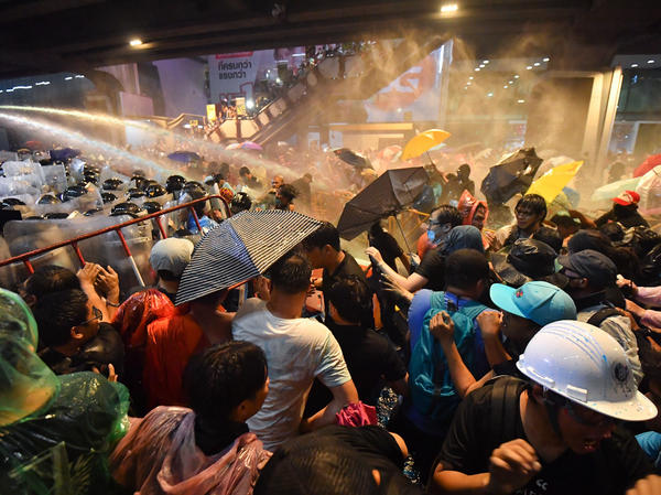 Riot police use water cannons to disperse pro-democracy protesters during an anti-government rally in Bangkok on Friday.