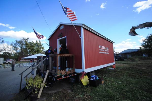A model of a tiny home sits at the site of the first Veterans Community Project village in St. Louis on Friday. The village, located in north St. Louis' JeffVanderLou neighborhood, provides transition housing for homeless veterans.
