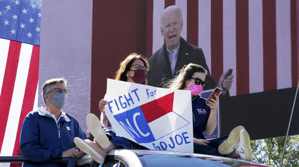 Supporters listen as Democratic presidential nominee Joe Biden speaks during a drive-in campaign event at Riverside High School in Durham, N.C., on Sunday.