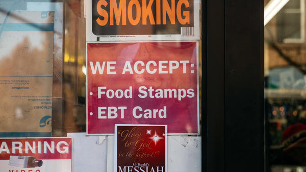 "A judge has tossed out a U.S. Department of Agriculture rule that would have limited food stamps, noting that during the pandemic ""SNAP rosters have grown by over 17 percent with over 6 million new enrollees."" Here, a sign alerts customers about food stamps at a store in New York City."