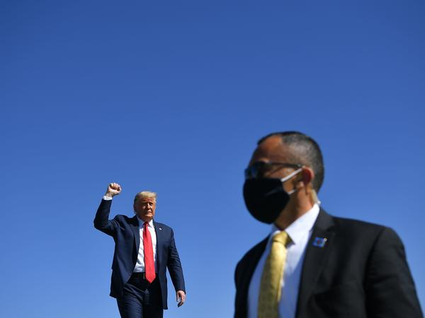 President Trump arrives to speak during a rally Monday at Prescott Regional Airport in Prescott, Ariz., one of many stops he has made recently in potential swing states.