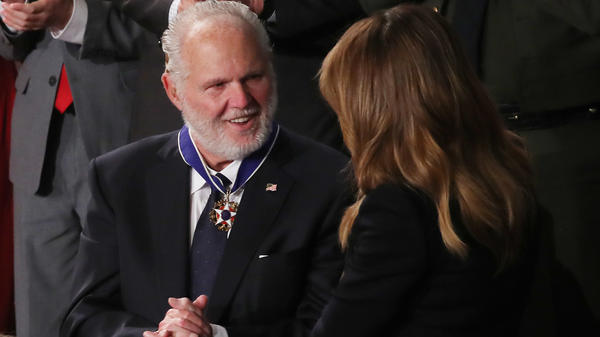 Rush Limbaugh says he intends to keep putting on his radio show despite his stage 4 lung cancer that he says has recently progressed. Here, he's seen reacting as first lady Melania Trump gives him the Presidential Medal of Freedom during the State of the Union address in February.