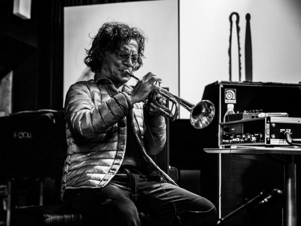 Esteemed jazz musician Toshinori Kondo playing the trumpet.