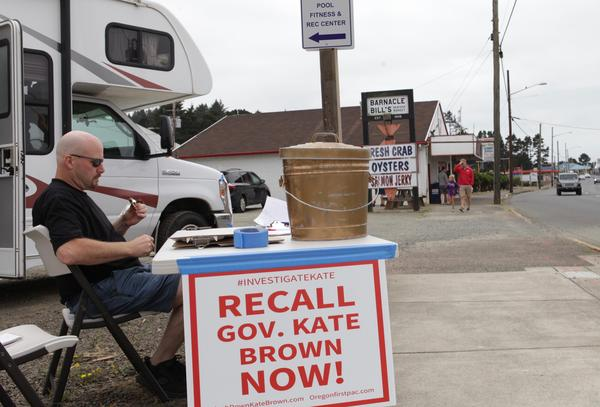 "Michael Cross, leader of the ""Flush Down Kate Brown"" campaign, collects signatures for a recall petition on Aug. 7, 2019."