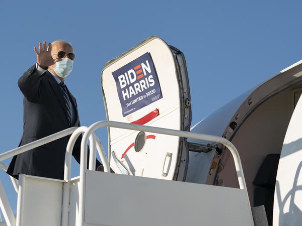 Democratic presidential nominee Joe Biden boards his campaign plane.