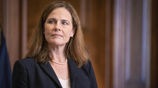 In a near-party-line vote Sunday, Senate Republicans advanced President Trump's Supreme Court nominee, Judge Amy Coney Barrett, seen here on Capitol Hill on Wednesday. A final confirmation vote is set for Monday evening.