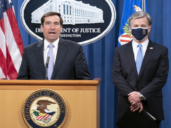 Assistant Attorney General for National Security John Demers speaks during a virtual news conference at the Department of Justice, Wednesday, Oct. 28, 2020 with FBI Director Christopher Wray.