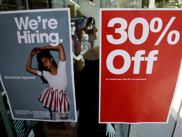Signs in the window of a retail store offers discounts, and jobs, in Santa Monica, Calif. U.S. GDP grew at a record-setting rate, reflecting pent-up activity after the coronavirus lockdowns, but economists warn of trouble ahead.
