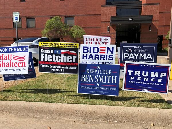 Election signs are seen outside a polling station this month in Plano, Texas.