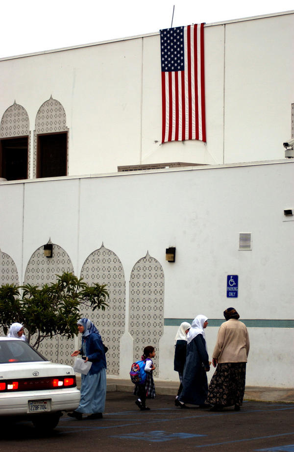 Parents bring their children to school near a mosque at the Islamic Center of San Diego, Sept. 19, 2001. The current head of the center says before Sept. 11 the Muslim community was insular. He now hosts interfaith meetings and participates in community groups.