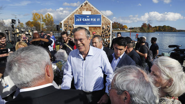 "Jeb Bush stood under a ""Jeb Can Fix It"" sign during a campaign stop outside Geno's Chowder and Sandwich Shop in Portsmouth, N.H., on Thursday."