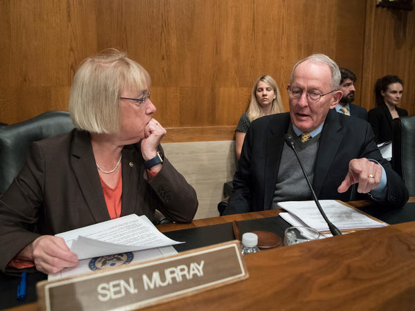 Sen. Patty Murray, D-Wash., the ranking member, and Sen. Lamar Alexander, R-Tenn., chairman of the Senate Health, Education, Labor, and Pensions Committee, meet before the start of a hearing on Capitol Hill in Washington, Wednesday, Oct. 18, 2017, the morning after they reached a deal to resume federal payments to health insurers that President Donald Trump had halted.