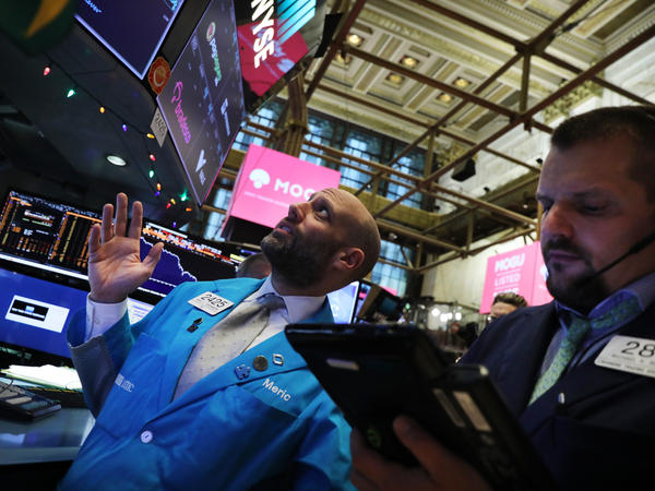 Traders work on the floor of the New York Stock Exchange on Thursday. Stocks plunged for the second trading day in a row but recovered late in the day.