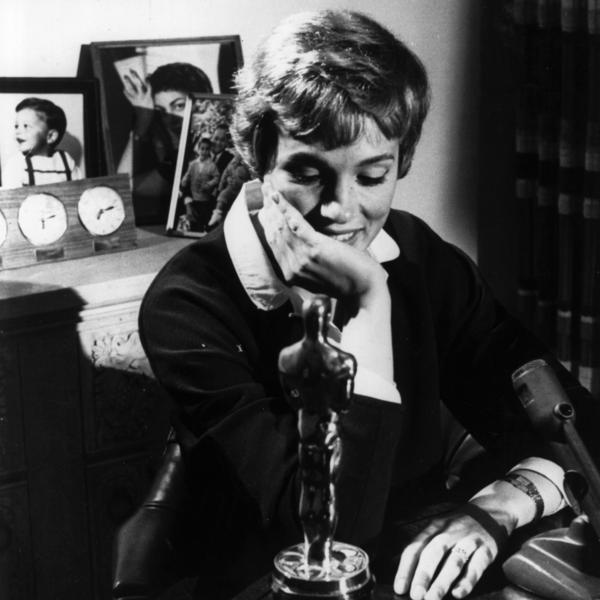 A younger Julie Andrews poses with the Academy Award she won for her role in <em>Mary Poppins</em>.