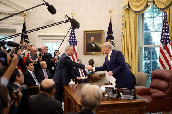 President Trump shakes hands with Chinese Vice Premier Liu He in the Oval Office at the White House on Oct. 11 in Washington, D.C. Trump announced a 'Phase 1' partial trade deal with China.