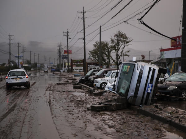Typhoon Hagibis left overturned cars and mud-slicked streets in Hoyasu, Japan. Rescue crews are still combing through areas that flooded after extreme rain caused rivers to break through levees.
