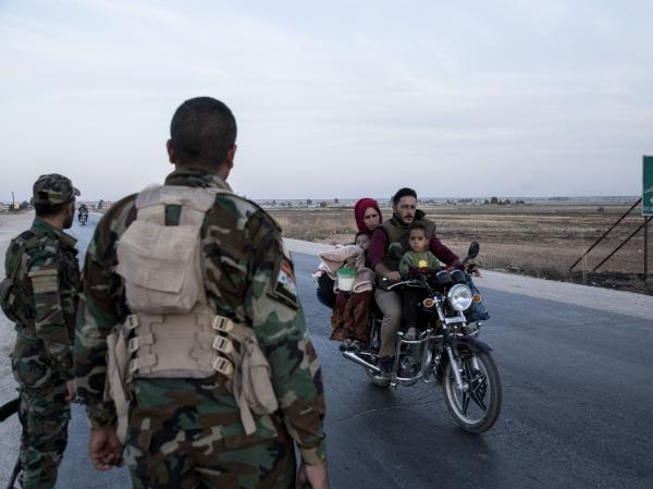 Syrian government troops on Monday moved into towns in northern Syrian formerly controlled by U.S.-backed Kurdish militants. That sets up a potential clash with Turkish forces.
