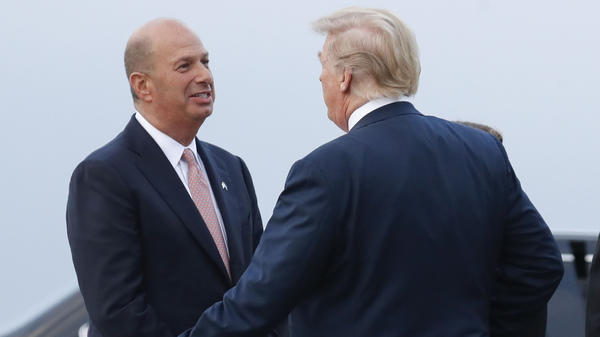 U.S. Ambassador to the European Union Gordon Sondland speaks with President Trump at Melsbroek Air Base in July 2018 in Brussels. Sondland is speaking to House committees on Thursday.