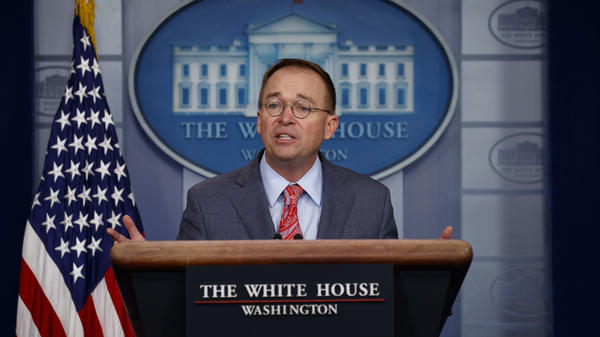 White House chief of staff Mick Mulvaney speaks to reporters in the White House press briefing room on Thursday.
