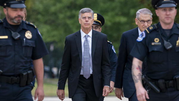Acting Ambassador William Taylor is escorted by U.S. Capitol Police on Tuesday as he arrives to testify before House committees as part of the Democrats' impeachment inquiry into President Trump.