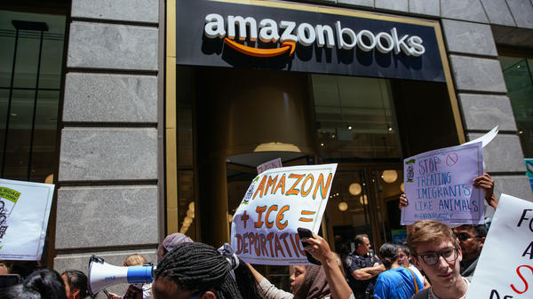 Protesters march to an Amazon store to raise awareness of Amazon's facilitation of surveillance efforts by Immigration and Customs Enforcement.