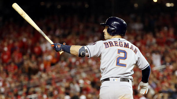 Alex Bregman of the Houston Astros hits a grand slam during the seventh inning in Game Four of the 2019 World Series at Nationals Park on Saturday. The World Series is now tied 2-2.