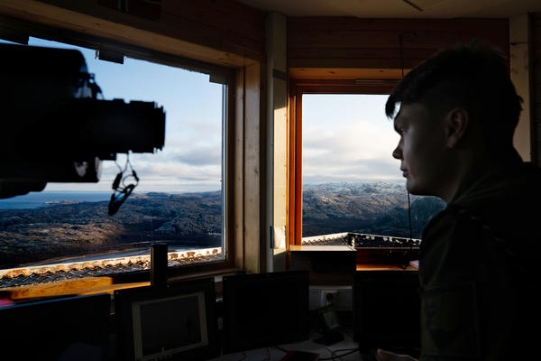 Norwegian Pvt. Ivan Sjoetun sits in the border post where Russian land can be seen out the window. The post is in the far northeast corner of Norway and offers a commanding view of this starkly beautiful area some 250 miles above the Arctic Circle.