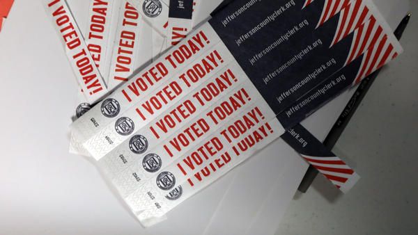 """Despite unanswered questions about security and transparency, mobile voting pilots aimed at overseas and military voters move forward in a number of states. Above, wristbands noting """"I Voted Today!"""" are available at Sojourn Community Church in Louisville, Ky., on Election Day this year."""