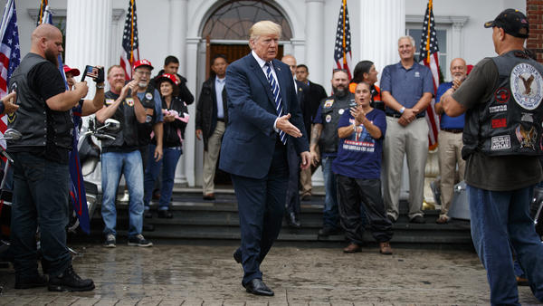 President Trump greets supporters in August 2018 at the Trump National Golf Club in Bedminster, N.J. He is fighting several state and congressional efforts to view his tax returns.