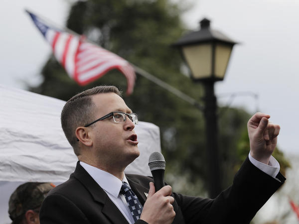 Republican state Rep. Matt Shea, pictured at a gun rights rally in January, has been suspended from the House Republican Caucus and removed from several committees.