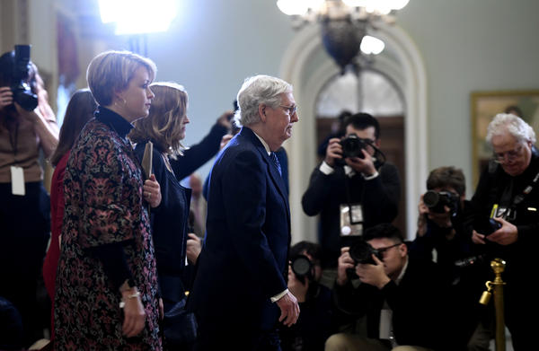 Senate Majority Leader Mitch McConnell, R-Ky., walks toward the Senate floor on Capitol Hill on Wednesday. His party stayed largely united in voting to acquit President Trump on two articles of impeachment.