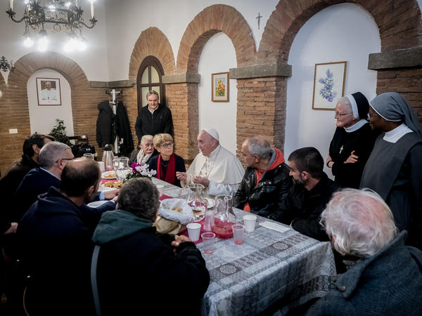 """Pope Francis shares a meal with guests and volunteers of the """"Palace of the Poor."""""""