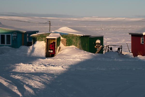 A census worker goes door to door in January to count some of Alaska's most remote residents in Toksook Bay. Warming temperatures and thawing permafrost are making it harder to get an accurate count for the 2020 census in some Alaska Native villages.