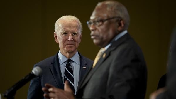 Democratic presidential candidate and former Vice President Joe Biden looks on as U.S. Rep. and House Majority Whip James Clyburn, D-S.C., announces his endorsement of Biden at Trident Technical College on Wednesday in North Charleston, South Carolina.