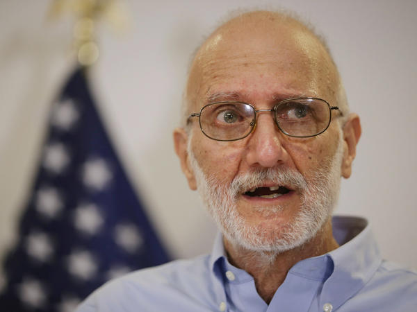 Alan Gross makes a statement  after arriving back in the United States on Dec. 17, 2014. A U.S. Agency for International Development subcontractor, Gross was imprisoned in Cuba for five years on espionage charges. He told NPR that Sen. Bernie Sanders visited him in detention and remarked that he didn't understand why others criticized Cuba.