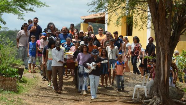 Mourners gather for a heartfelt burial ceremony in the Brazilian film <em>Bacurau</em>.