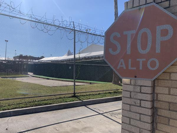 The outside of a MPP court facility in Brownsville is guarded with barbed wire.