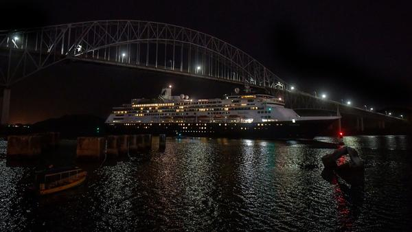 Holland America's cruise ship Zaandam navigates through the Panama Canal on Sunday. Passengers and crew, some of whom may have COVID-19, have been stranded on the ship while looking for a country to accept them.