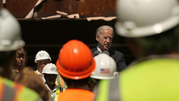 In 2010, Vice President Joe Biden speaks to construction workers at the Brooklyn Bridge, marking a renovation project which was partly funded by money from the 2009 Recovery Act.