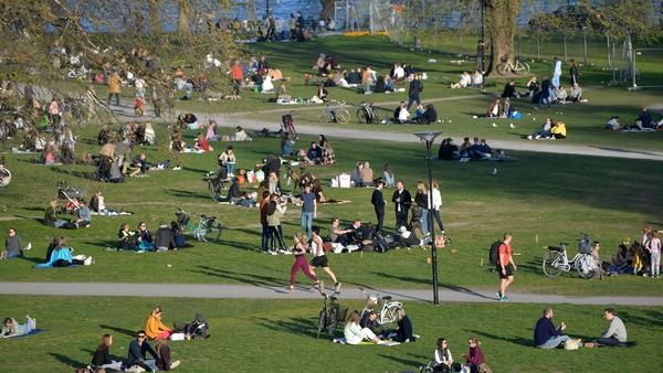 People enjoy high temperatures on April 22 in Stockholm. Sweden has not imposed the extraordinary lockdown measures seen across Europe.
