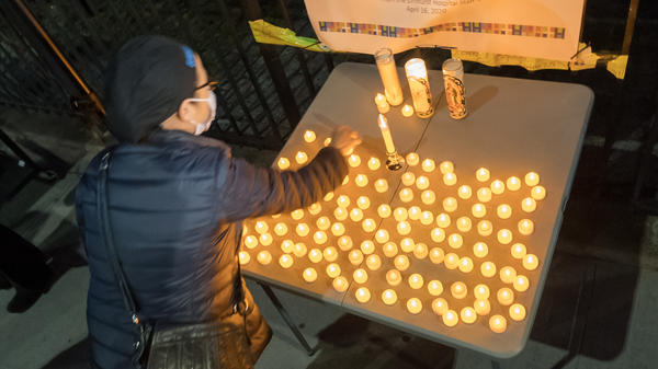 The U.S. death toll from COVID-19 hit a new milestone, surpassing the number of Americans who died in the prolonged conflict with Vietnam. Here, the Elmhurst Hospital Center in Queens, N.Y., holds a vigil for medical workers and patients who have died in the pandemic.
