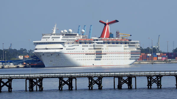 Carnival Cruise Line's Ecstasy is docked amid the coronavirus outbreak on March 27 in Jacksonville, Fla. Carnival says it's planning to resume cruises beginning in August