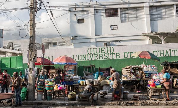 A busy market near the state hospital in downtown Port-au-Prince. Despite a halt to air travel and other lockdown measures, Port-au-Prince looks as busy as ever, observers say.