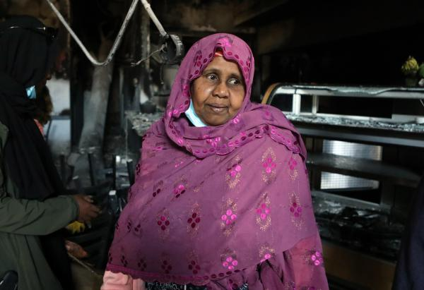 Safia Munye looks over the remains of her restaurant, Mama Safia's Kitchen, on Saturday. It was destroyed last week during protests in Minneapolis.