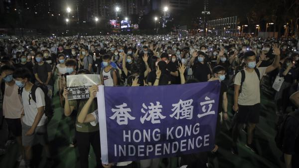 "People attending a vigil for the victims of the 1989 Tiananmen Square massacre hold a banner reading ""Hong Kong independence"" at Victoria Park in Causeway Bay, Hong Kong, on Thursday. Official applications for the rally were denied."