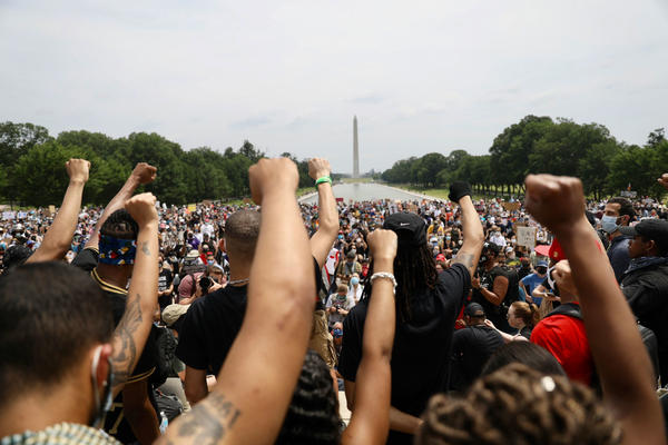 Protesters peacefully gather at the Lincoln Memorial on Saturday in Washington to call for action to end racial injustice.
